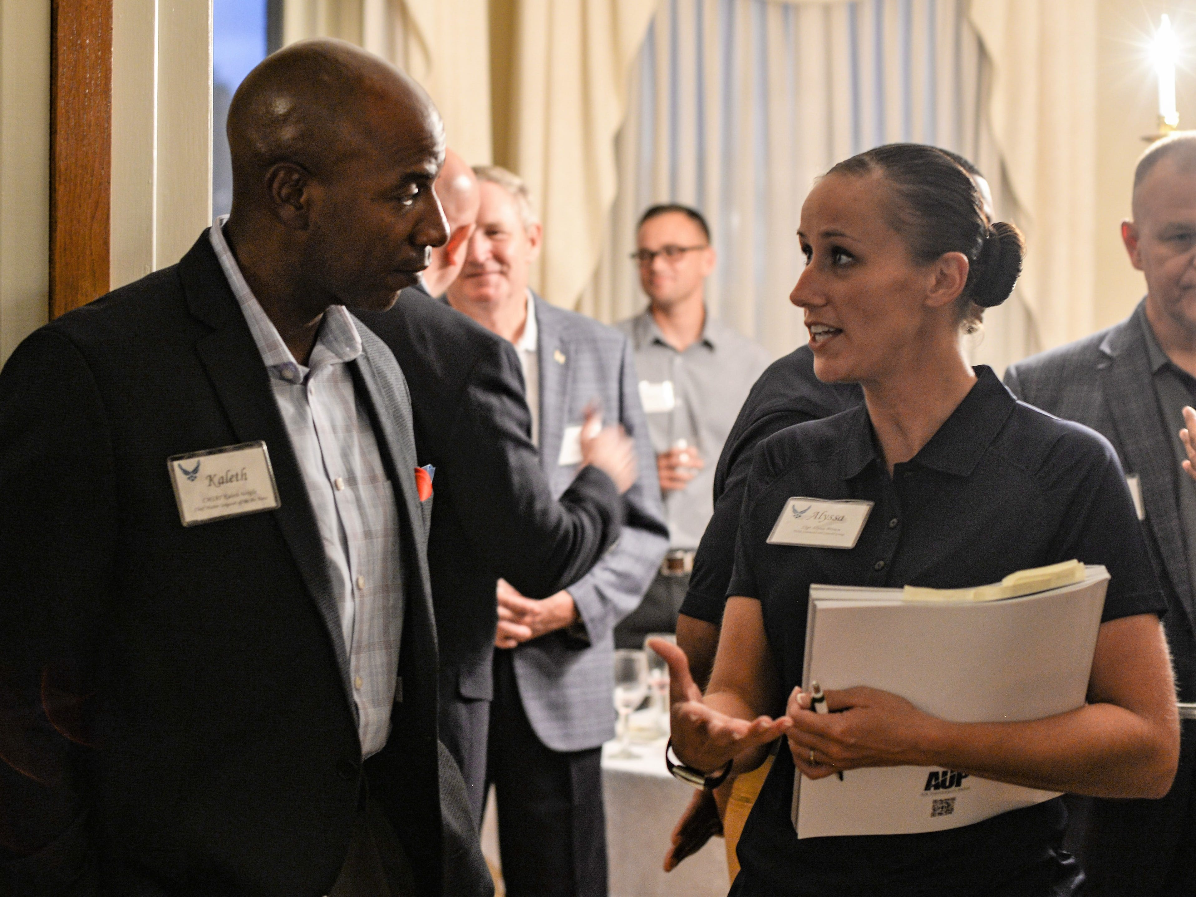 Chief Master Sgt. of the Air Force Kaleth O. Wright and Staff Sgt. Alyssa Brown, assigned to the 595th Command and Control Group, speak during a social the day before the 2018 Senior Enlisted Statesmen Forum Sept. 5, at Offutt Air Force Base, Nebraska. Brown was one of six aidesNCOs hand selected to assist the former Chief Master Sergeants of the Air Force during their visit.