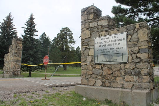 The Sunspot Observatory entrance was blocked with a stop sign and yellow crime scene tape Friday morning. The facility is temporarily closed until further notice.