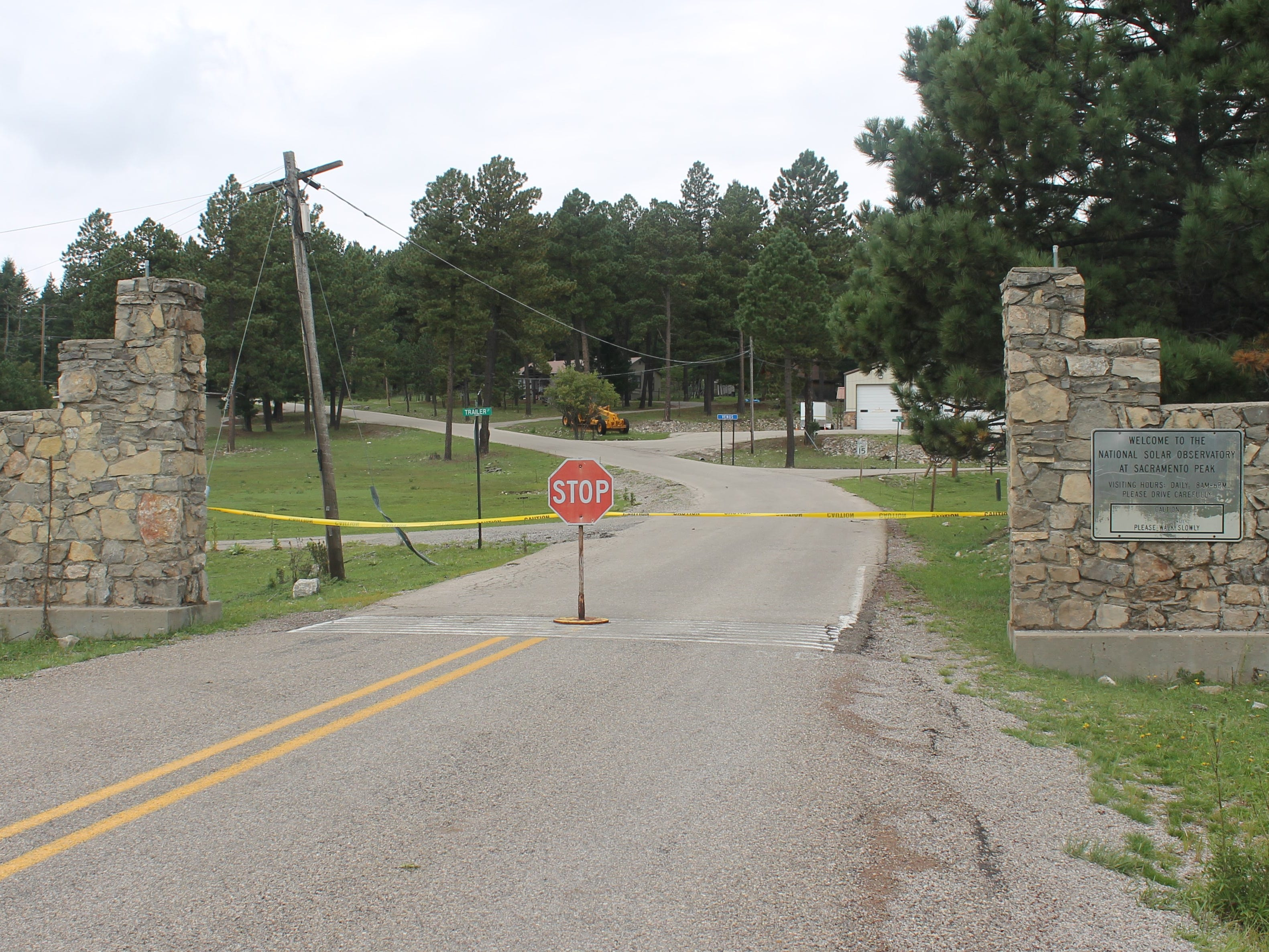 A stop sign and yellow crime scene tap at the entrance to Sunspot Observatory's entrance Friday morning. The facility was closed due to a security issue.