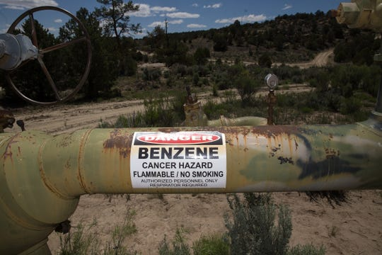 A caution sign is visible, Monday, May 15, 2017 at an oil and gas site at Devil's Spring Ranch in Gobernador.