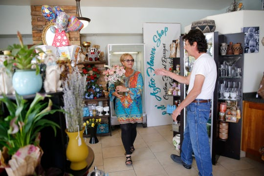 Susan Aguirre, owner of Lil Aztec Flower Shop talks with customer Guillermo Garcia, Thursday, Sept. 6, 2018 at her flower shop on South Main Avenue in Aztec.