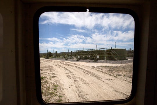 Jane Shriver drives past an oil and gas site, Monday, May 15, 2017 located near her ranch in Gobernador.
