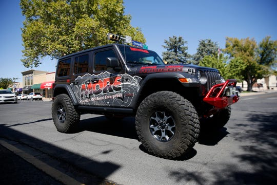 A Jeep Rubicon drives past the Three Rivers Brewery Friday during a lunch event for the Four Corners 4x4 Week in Farmington.