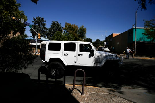 A driver of a Jeep Rubicon searches for a parking spot near the Three Rivers Brewery Friday during a lunch event for the Four Corners 4x4 Week in Farmington.