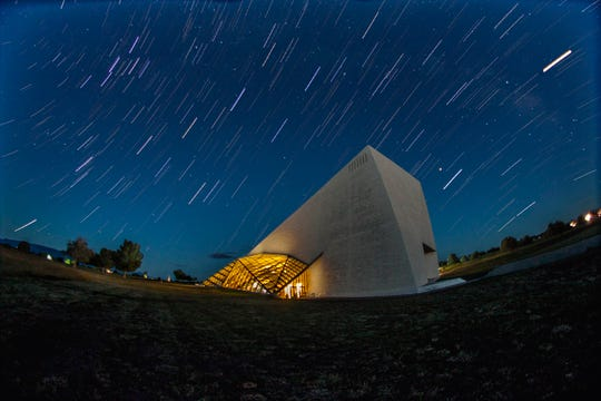 Slow shutters created streaks of stars in the sky over the Spencer Theater.