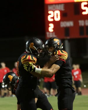 Palm Desert celebrates a touchdown in a 42-0 win over Yucca Valley.