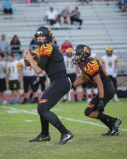 Carter Stokes looking to pass the ball. The Palm Desert varsity football team won Thursday's home non-conference game against Yucca Valley (CA) by a score of 42-0.