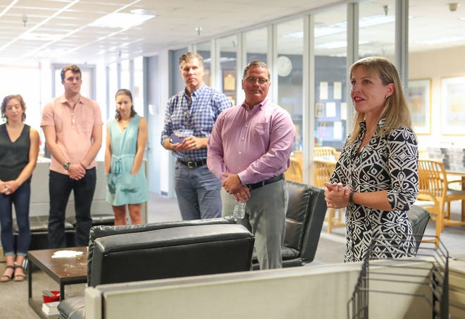 Julie Makinen (to the far right) is seen talking to the Desert Sun newsroom as she's introduced as the new executive editor.