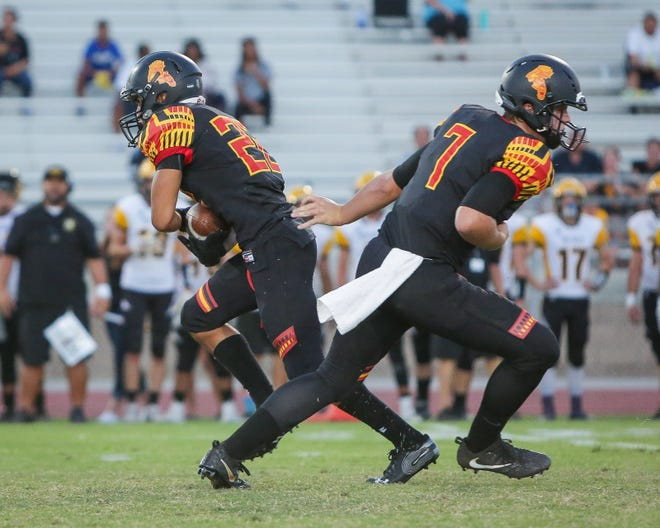 Carter Stokes hands off the ball to Jordan Garcia. The Palm Desert varsity football team won Thursday's home non-conference game against Yucca Valley (CA) by a score of 42-0.