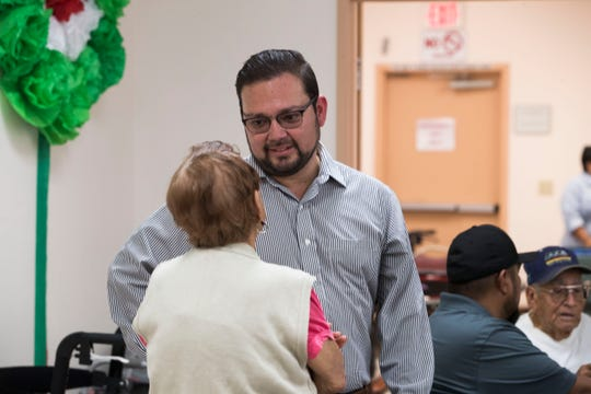 Coachella Mayor Steve Hernandez photographed on September 7, 2018 in the city of Coachella. In this photo Hernandez speaks to a senior at the Coachella Senior Center.