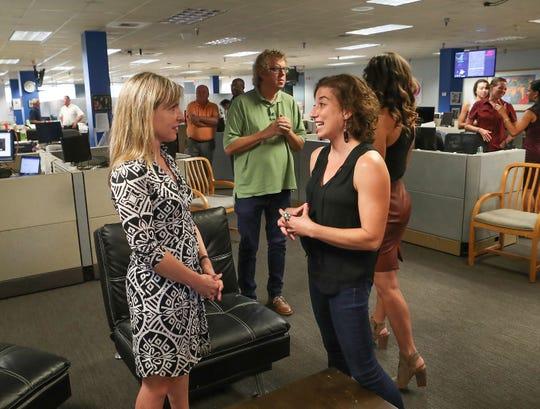 Julie Makinen (to the far left) is seen talking to Desert Sun reporter Rebecca Plevin.