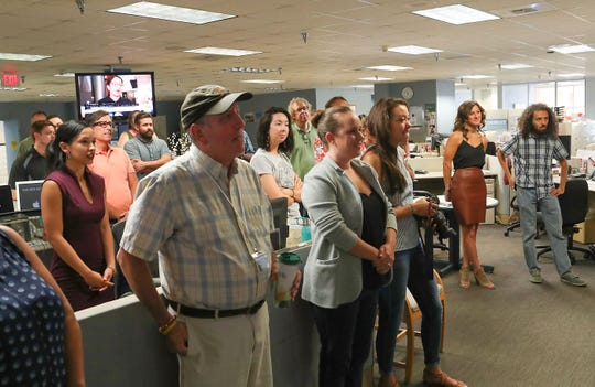 The newsroom reacts to the announcement that Julie Makinen will be the new executive editor.