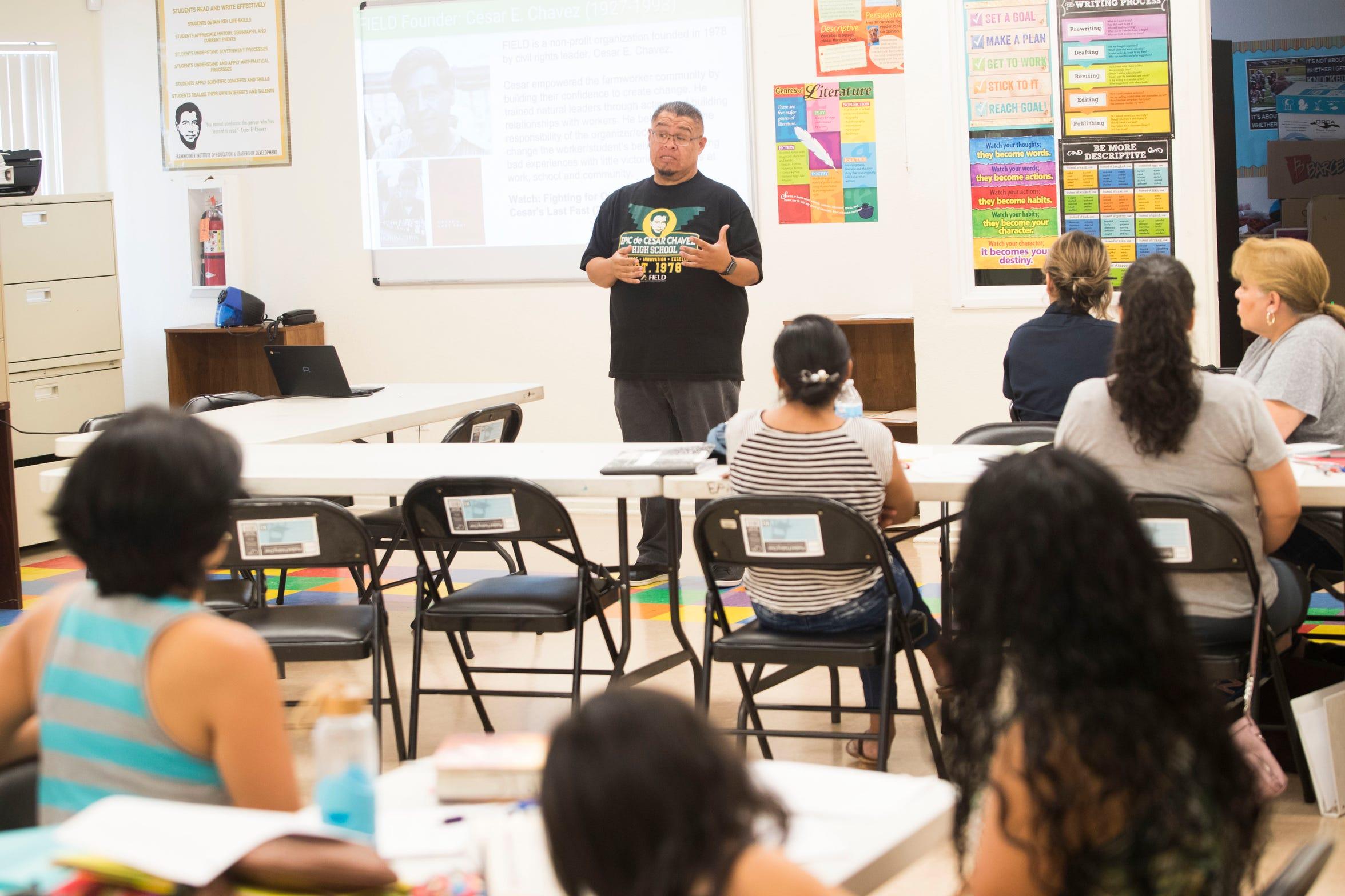 Joe Mota, a founding member of Raices speaks at a workshop for adult high school in Desert Hot Springs on September 7, 2018.