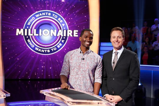 "Pensacola resident Malcolm Brooks poses for a photo with ""Who Wants to Be a Millionaire"" host Chris Harrison on July 11 in Las Vegas."