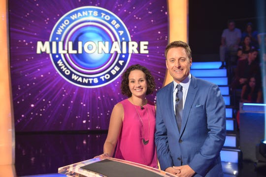 "Pensacola resident Keri Bucks poses for a photo with ""Who Wants to Be a Millionaire"" host Chris Harrison on July 12 in Las Vegas."