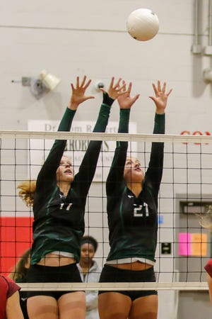 Pensacola Catholic's Hannah Meyers (17) and Molley Majewski (21) try to block a Jaguars' hit at West Florida High School on Thursday, September 6, 2018.