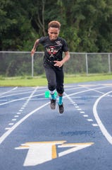 8-year-old Camron Chandler, of the Pensacola's Golden Elite Track Club, runs at the Booker T. Washington High School track in Pensacola on Thursday, September 6, 2018.