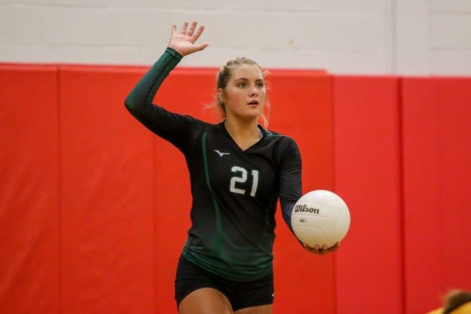 Pensacola Catholic's Molley Majewski (21) serves against the Jaguars at West Florida High School on Thursday, September 6, 2018.