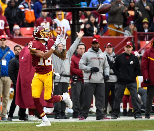 Redskins receiver Josh Doctson (18) catches a touchdown pass during a game against the Broncos.
