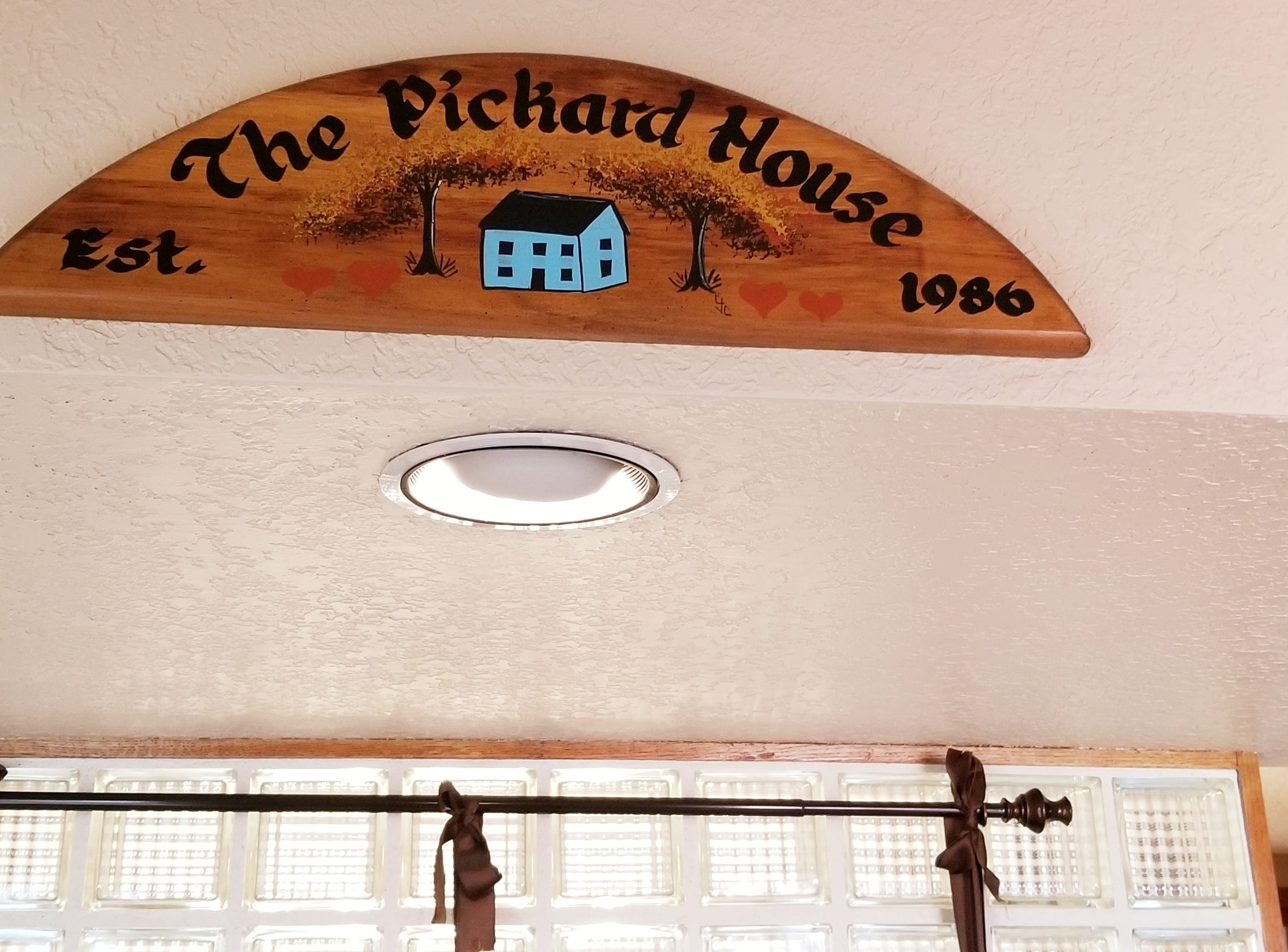 Tole painted signage hangs in the entry, declaring the Pickard House having been established in 1986.