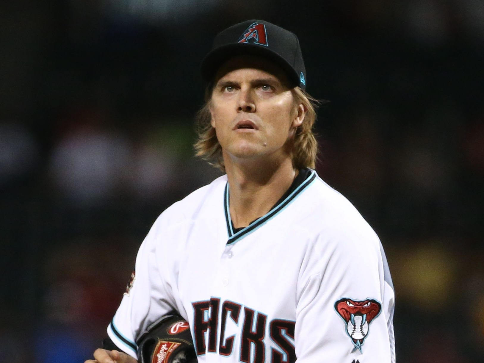 Arizona Diamondbacks 	starting pitcher Zack Greinke reacts after the Atlanta Braves scored two runs in the first inning on Sep. 6, 2018, at Chase Field in Phoenix, Ariz.