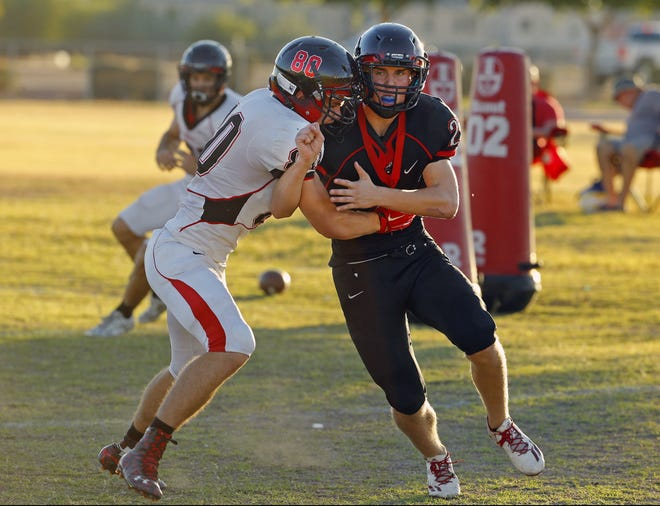 Liberty High School's safety Ryan Puskas tries to get around a blocker during practice Tuesday, Oct. 25, 2016 in Peoria,  Ariz.
