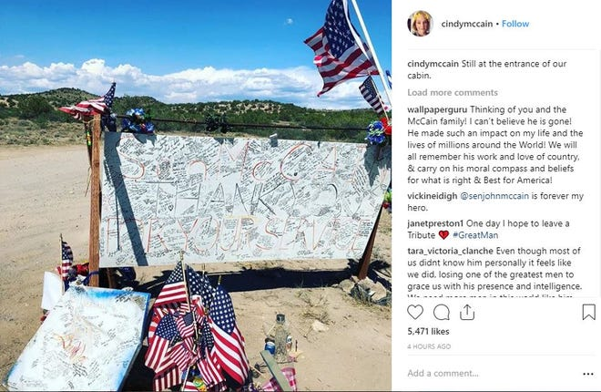 Cindy McCain shares a photo on Thursday of a memorial outside the McCains' cabin in Cornville, Arizona.