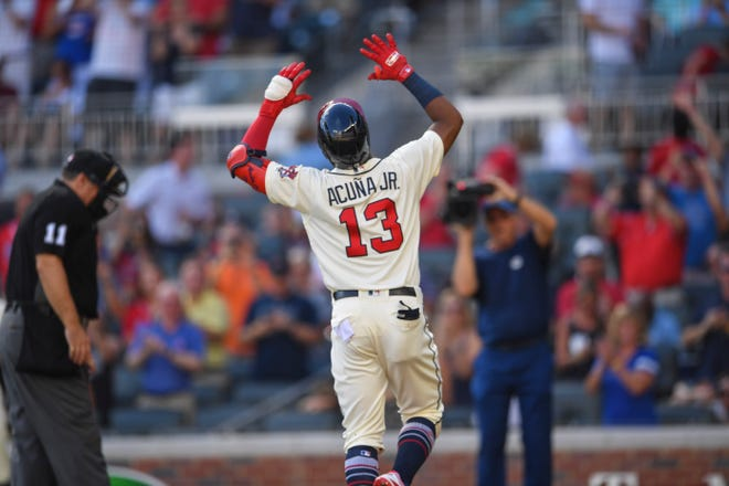 Sep 2, 2018: Atlanta Braves left fielder Ronald Acuna Jr. (13) runs the bases after hitting a lead off home run against the Pittsburgh Pirates during the first inning at SunTrust Park.