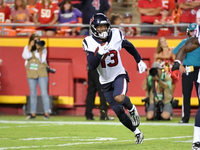 Houston Texans wide receiver Braxton Miller (13) runs the ball during the second half against the Kansas City Chiefs at Arrowhead Stadium.
