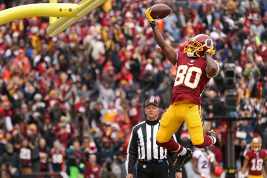 Redskins receiver Jamison Crowder (80) celebrates after catching a touchdown pass against the Broncos.