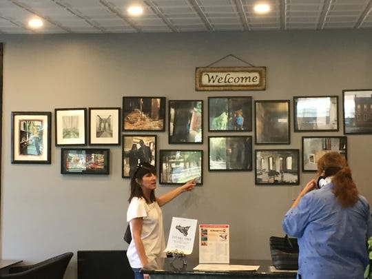 Customers admire a wall of photos showing the transformation of Taste of Sicily as a first-floor apartment to the restaurant it's become.