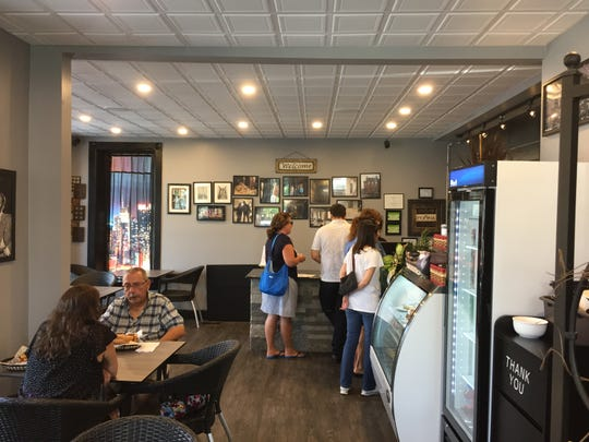 Customers line up at the counter at Taste of Sicily during lunch hours.