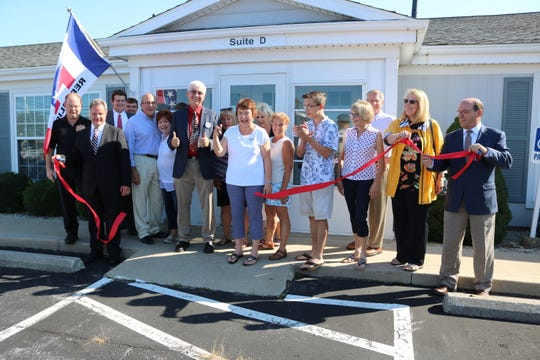 Jill Stinebaugh, chair of the Ottawa County Republican Party, cuts the ribbon at their new headquarters at 140 Buckeye Blvd., Suite D, Port Clinton, last week.