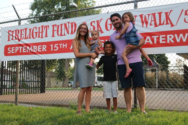 The Port Clinton Fire Department's 2018 Firelight Fund 5K benefited Stella Miller, right, who is battling a rare genetic disorder. She is pictured here with her family.