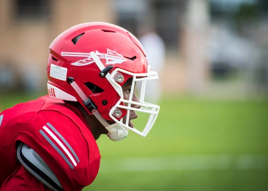 Port Huron High School wide receiver Shaka Brown waits before a warm up play Friday, Sept. 7, 2018, before the Big Reds take on Fraser High School at Memorial Stadium.