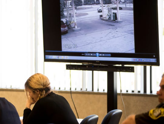 Theresa Gafken looks away from a video recording Friday, Sept. 7, 2018 during her trial in the St. Clair County Courthouse. The video evidence showed Gafken's vehicle traveling at a high rate of speed on 24th Street just before the fatal crash.