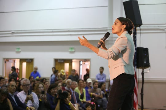 Alexandria Ocasio Cortez speaks during a rally for Zephyr Teachout's campaign for attorney general at SUNY New Paltz on September 7, 2018.