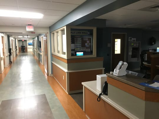 The nurses' station is dark at the Progressive Care Unit at Chambersburg Hospital, as seen Friday, September 7, 2018. The hospital has closed some rooms and is working to fix a moisture problem caused by unusually wet weather. The problem does not pose a health risk, according to the hospital.