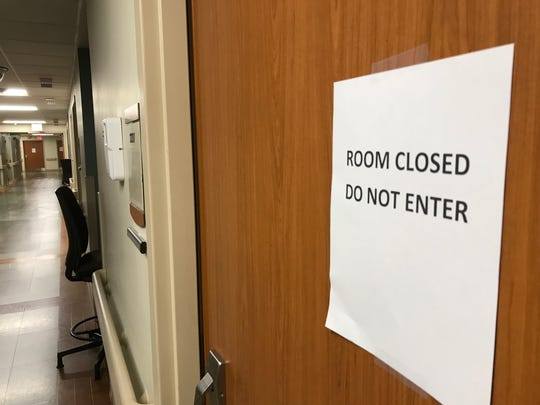 A sign appears on one of the 66 patient rooms that were closed at Chambersburg Hospital in September.