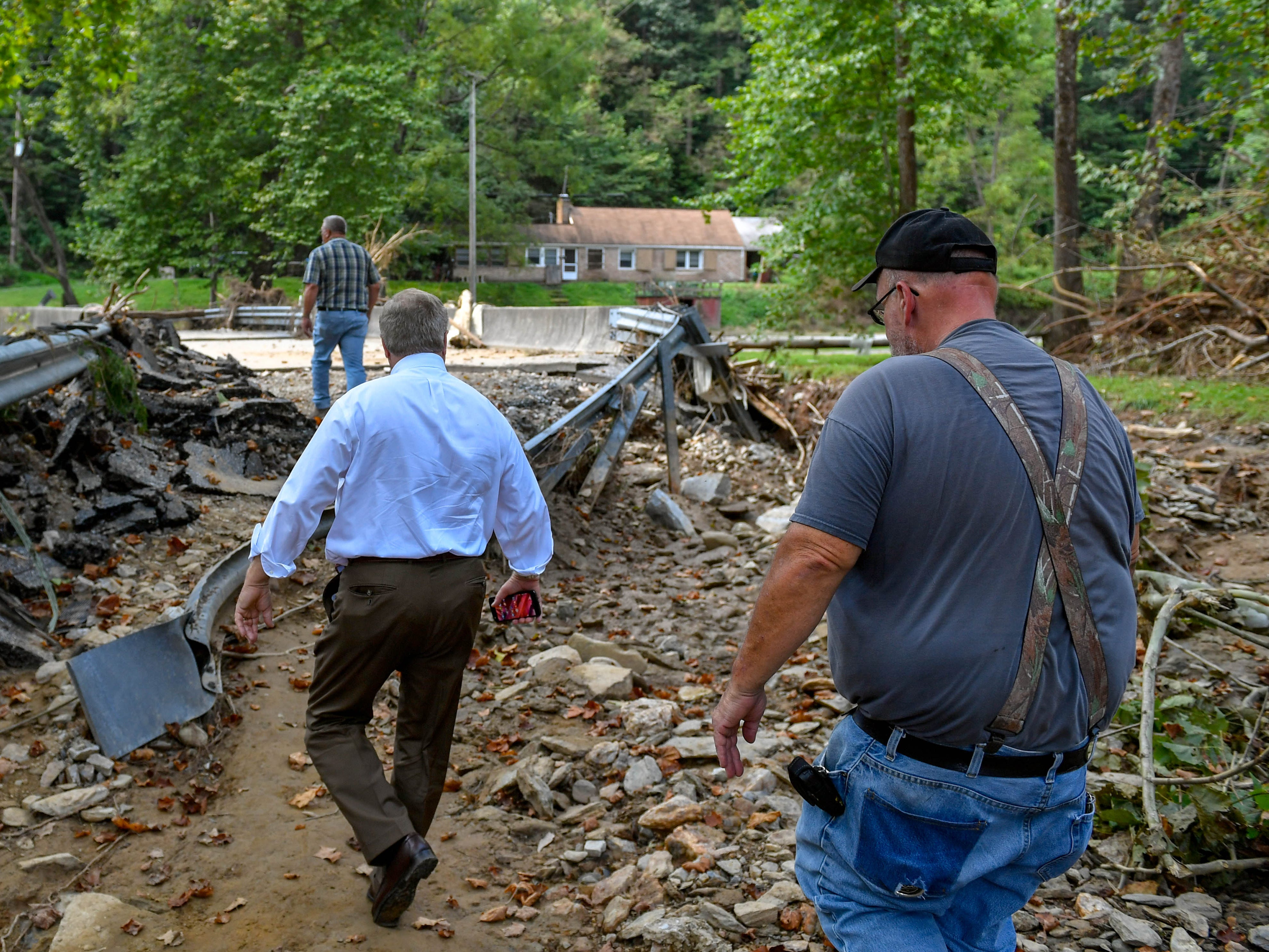 Warner (front), Wagner (middle) and Witmer (back) walk up what's left of Kline Road.