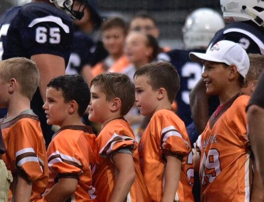 Area youth football players were on the field Friday night in Chambersburg before the game against Red Lion.