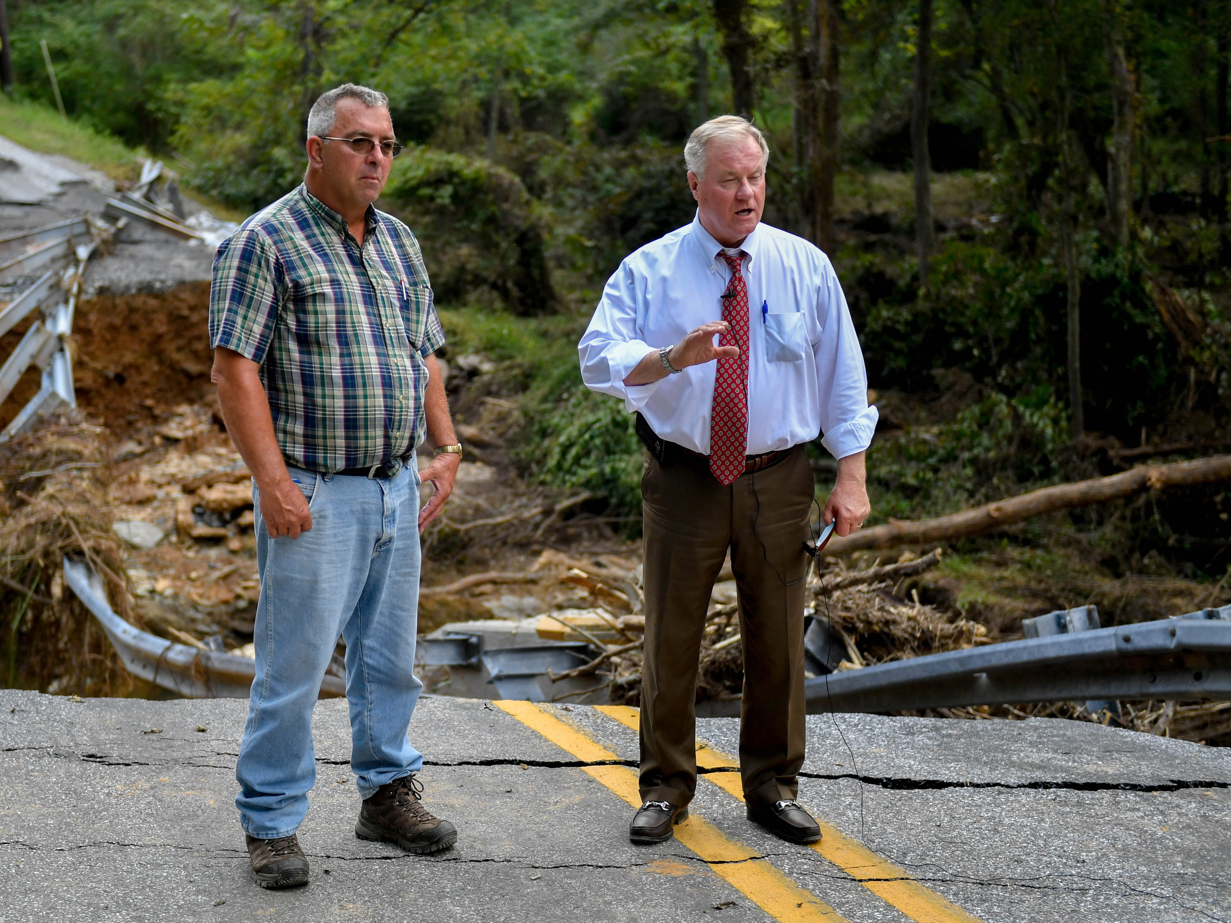 Scott Wagner (right) and Dave Warner (left) start a Facebook Live to show the flood devastation in Chanceford Township, Thursday, September 6, 2018.