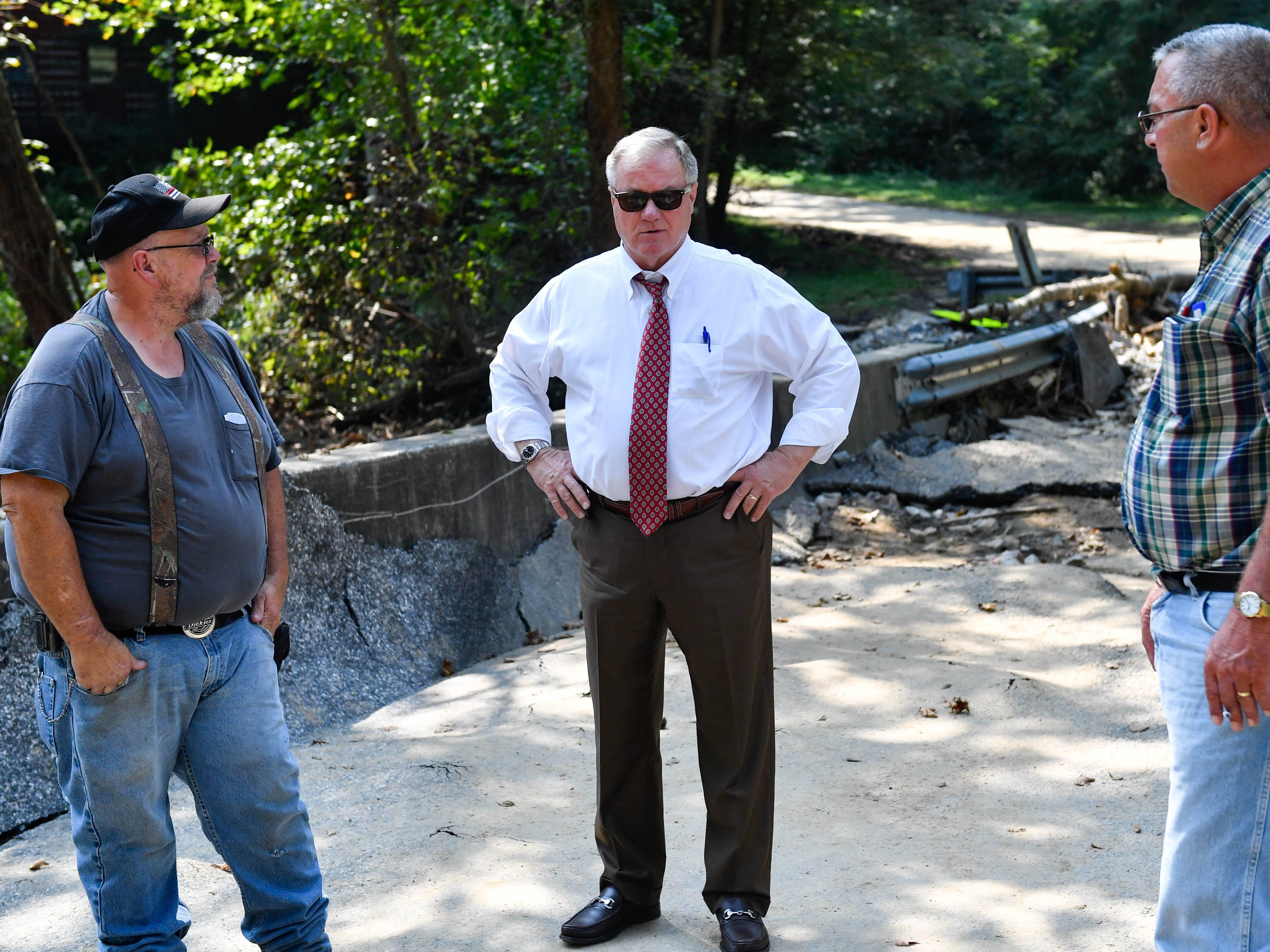 New Bridgeville Fire Chief Ron Witmer (left), former state senator Scott Wagner (middle) and Chanceford Township Supervisor Dave Warner discuss the extent of the flood damages on Thursday, September 6, 2018.