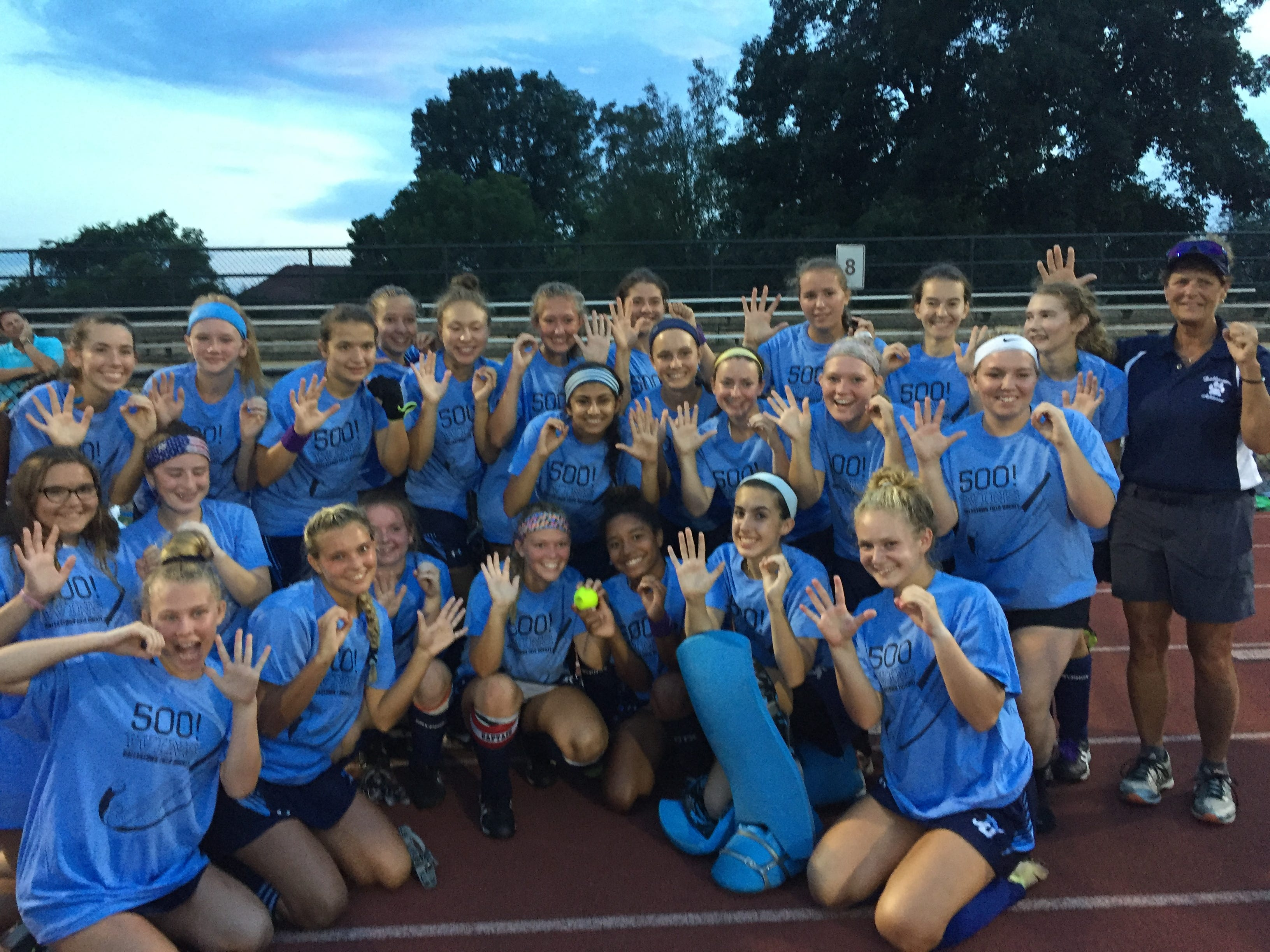 The Dallastown field hockey team poses after coach Jeri Myers earned her 500th win in a 6-0 victory over Dover on Thursday night.