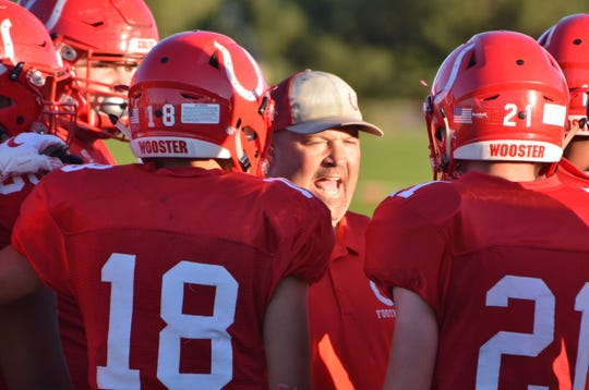 Bo Sellers coaches against Hug on Aug. 30.