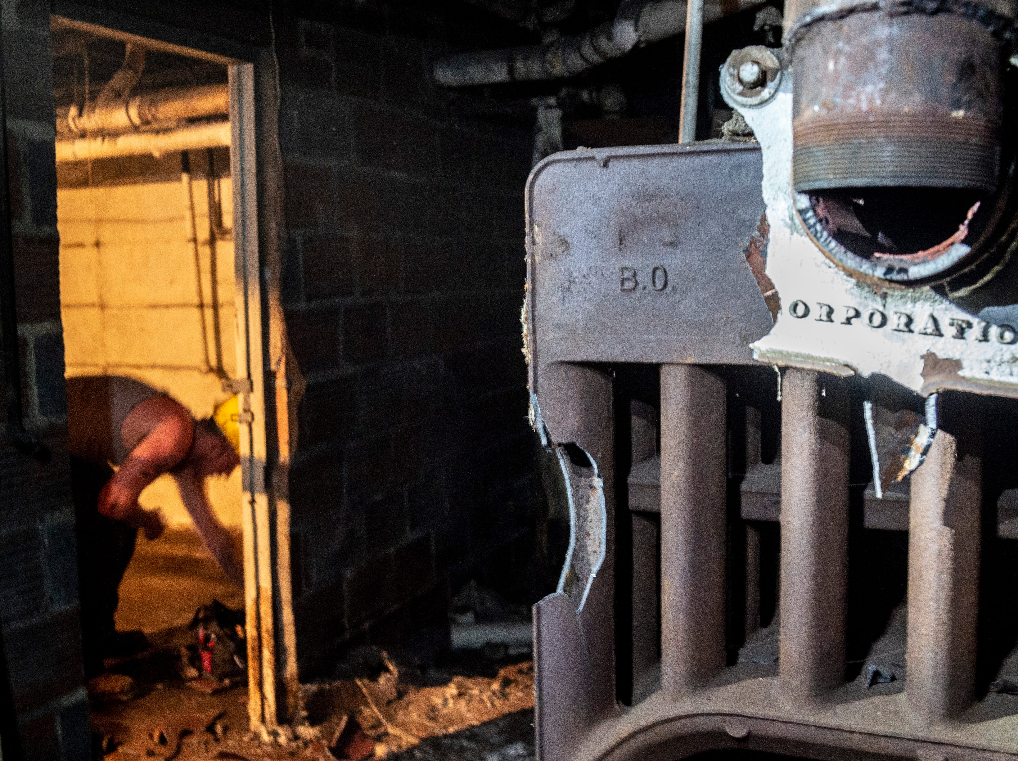 The boiler room in the basement of the Readmore building in downtown Richmond is seen during demoliton work on Sept. 4, 2018.