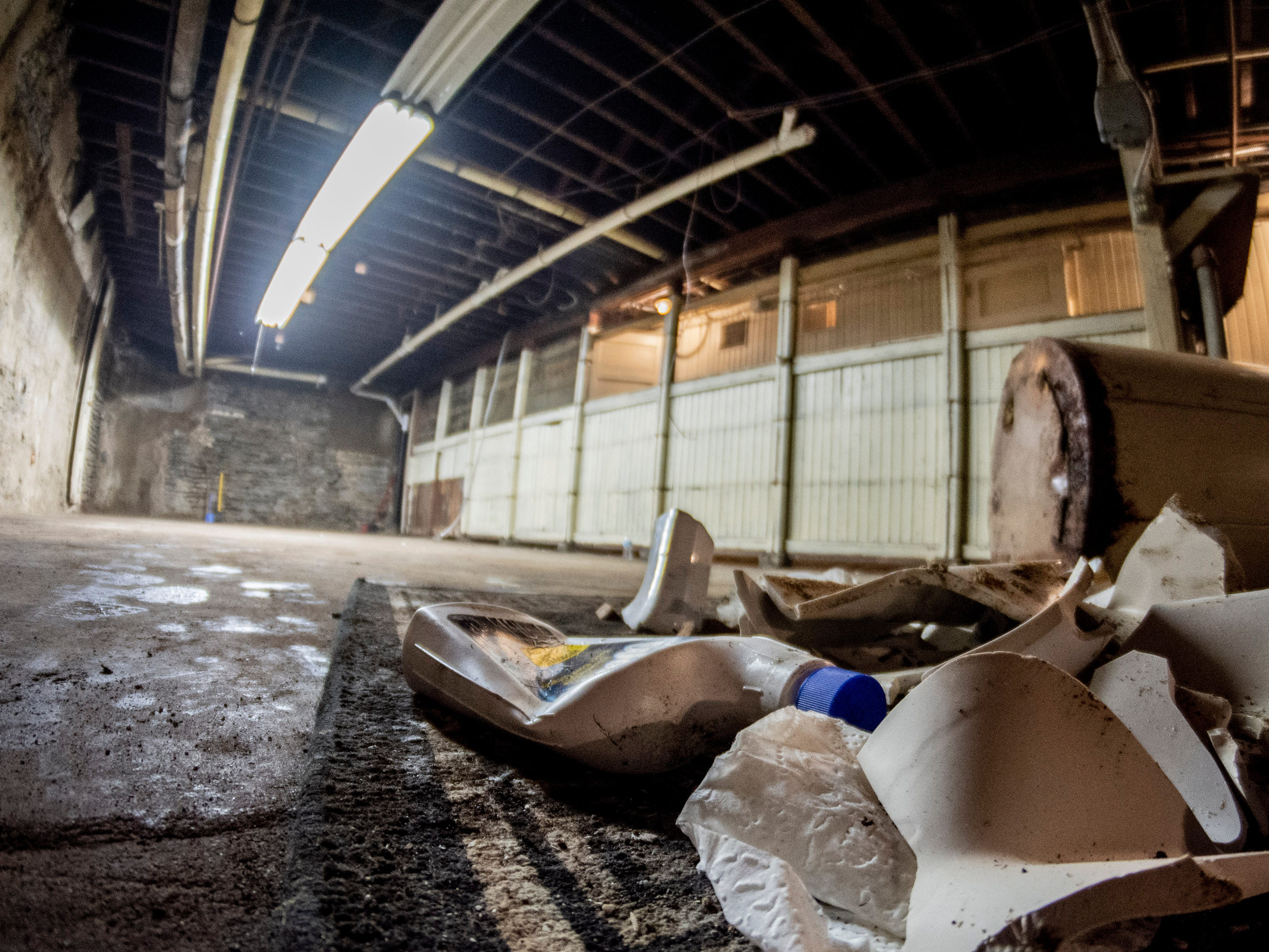 Trash is gathered into a pile in the basement of the Readmore building in downtown Richmond following demoliton work on Sept. 4, 2018.