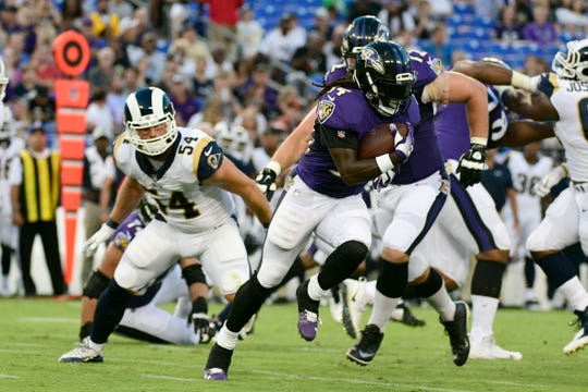 Ravens running back Alex Collins (34) fell just short of 1,000 yards rushing last season.