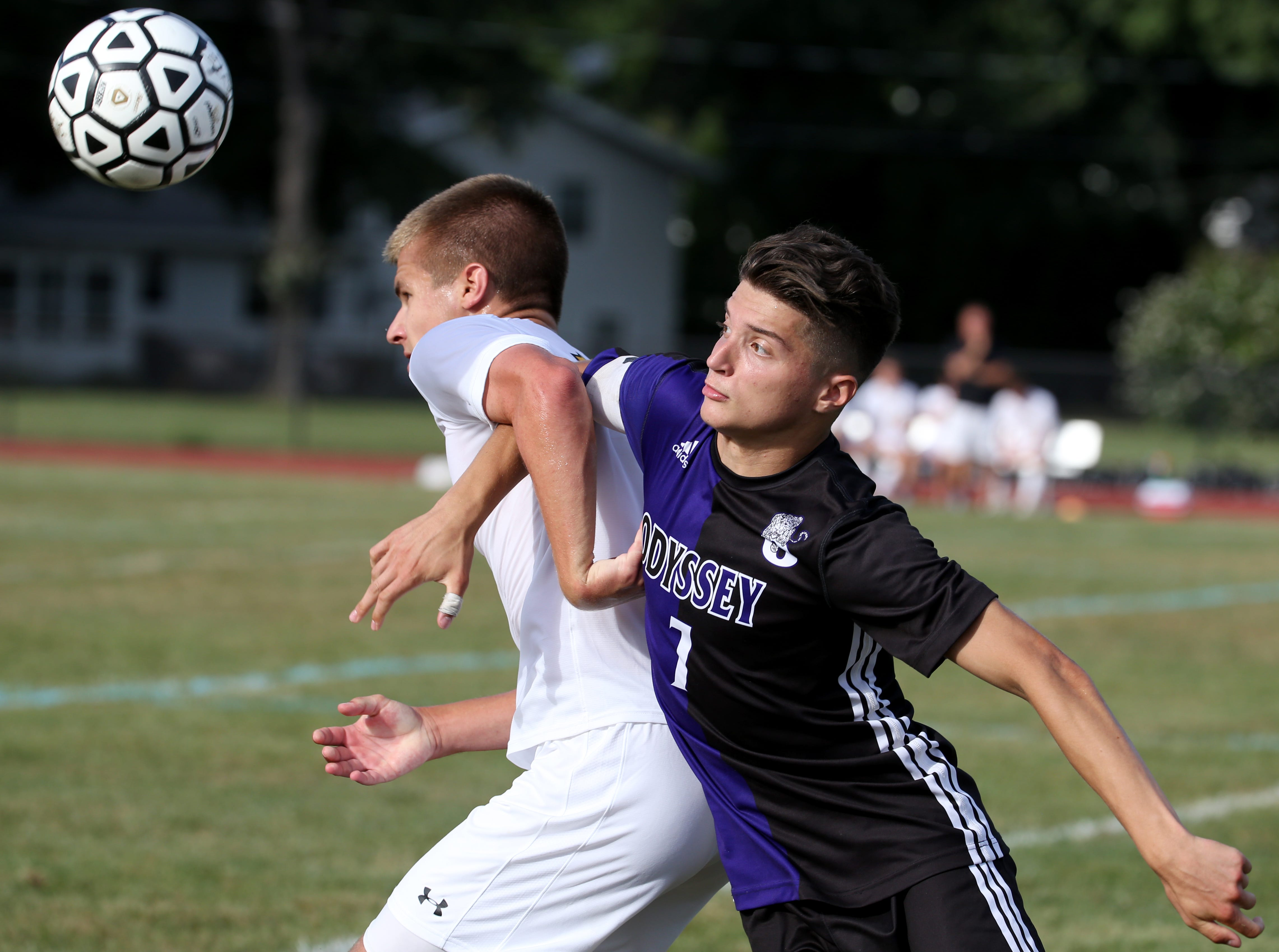 HF-L's Jack Emerson (11) and Greece Odyssey's Dylan Ange (7) battle for the ball Thursday night at Greece.