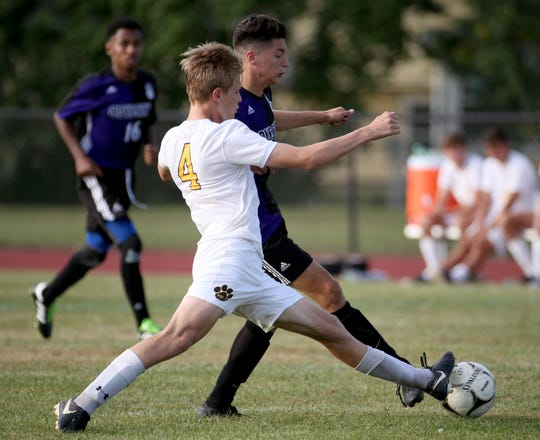 Greece Odyssey's Dylan Ange (7) vs HF-L's Chris Goetz (4) in soccer action Thursday night.